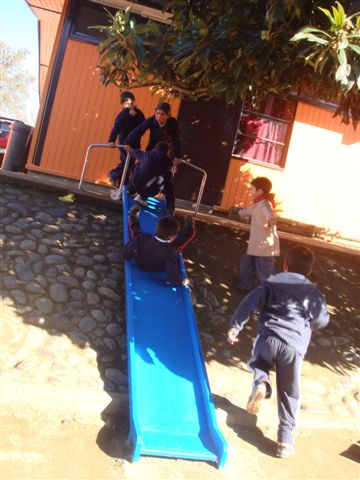 Students enjoying their new playground and green areas