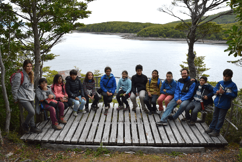 Monitors and the entire summer camp group taking a break at a lookout station