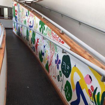 Mural painted by Katrine Clante, Bjørn Lie, Daniela William and Tomás Olivos in Escuela Carileufu, Caburgua