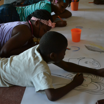 Workshop participants creating drawings for their future mural