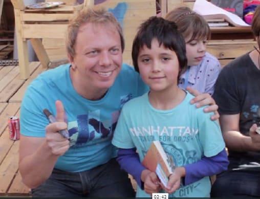 Cristian Dzwonik, alias Nik, creator of the comic book Gaturro, with one of his readers