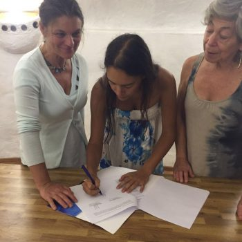 Madeline Hurtado and Mahani Teave signing this year's agreement
