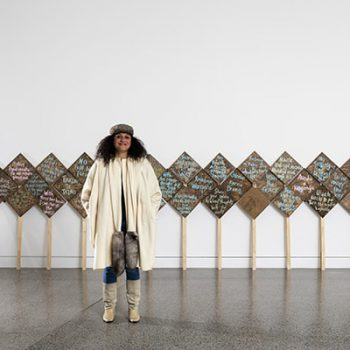 The New Zealand Maori artist, Charlotte Graham along with her work Picket Waka.