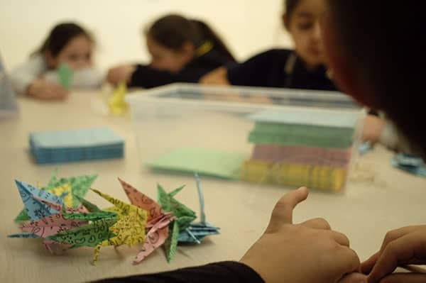 The first paper-crane workshop carried out with kids from local schools